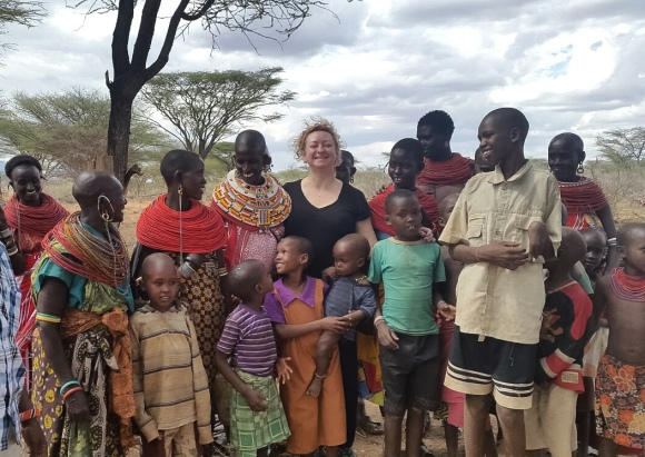 Mama Sarah in profile on left with members of the Ntilal #1 Well Community.